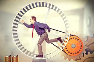 businessman run in huge hamster wheel